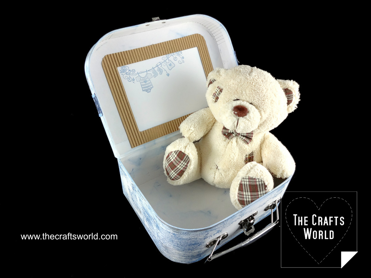Baby storage box with a teddy bear Open